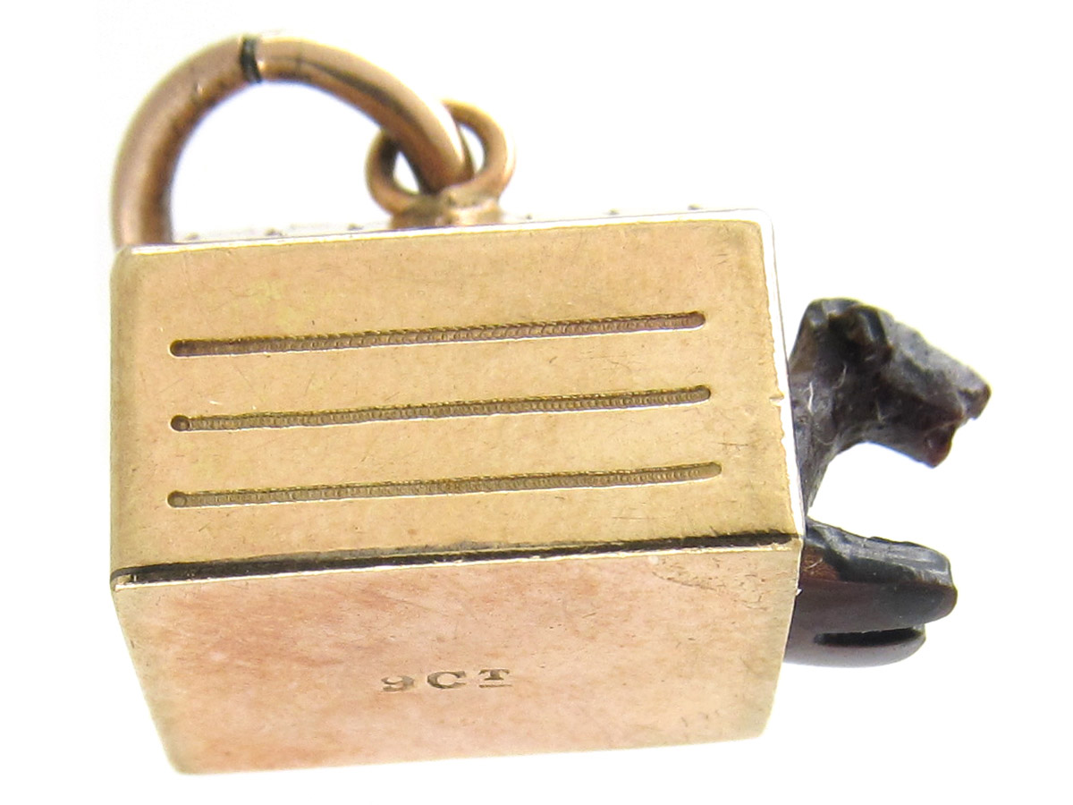 Gold Dog in Kennel Charm