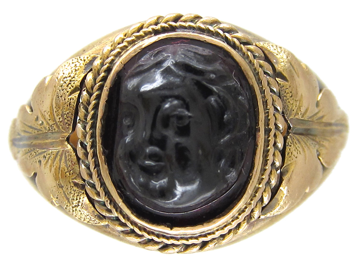 Victorian Gold Ring with a Carved Garnet of a Cherub's Head