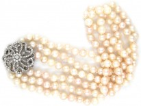Cultured Pearl Three Strand Necklace with Large Diamond Set Flower Clasp