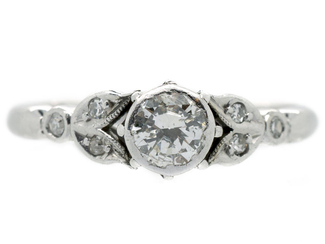 Solitaire Diamond Ring With Leaf Shoulders