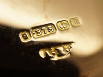 Edwardian 9ct Gold Round Locket With Buckle Motif