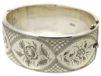 Silver Bangle With Engraved Flower Motif