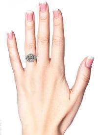 Art Deco Platinum & Three Stone Diamond Ring Within a Geometric Setting