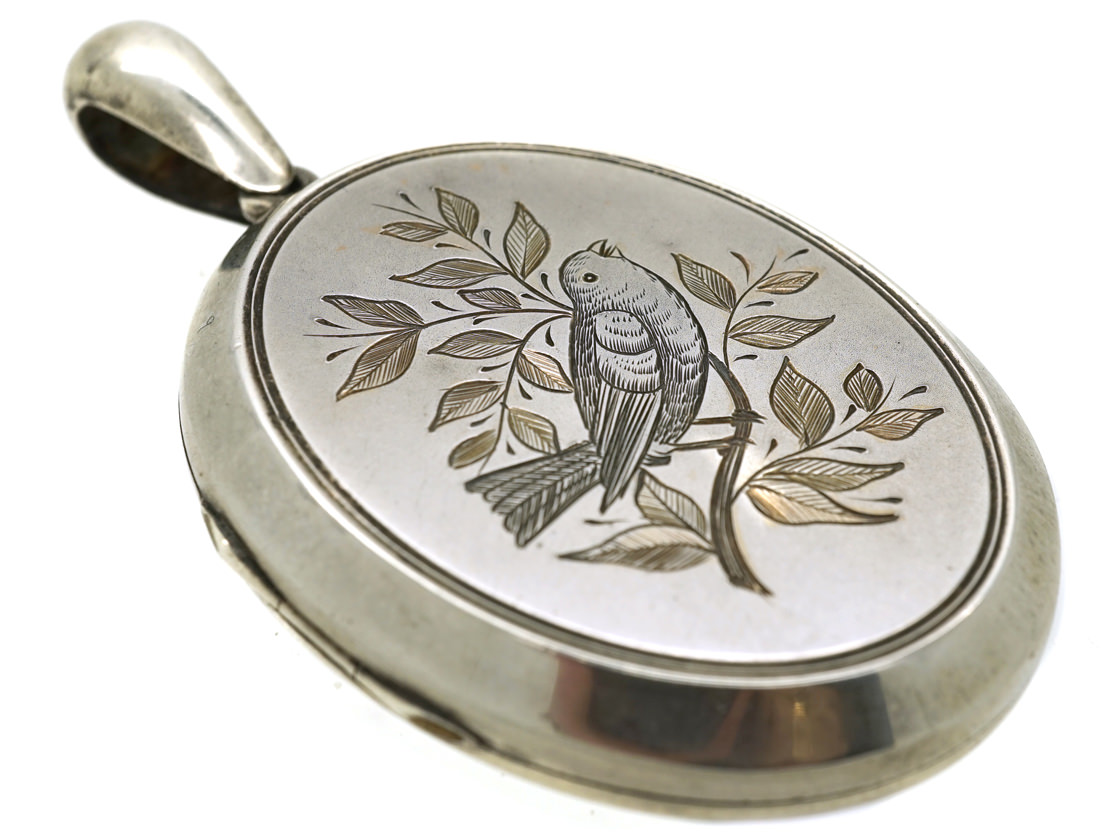 Victorian Silver Oval Shaped Locket With Bird in Bough Motif