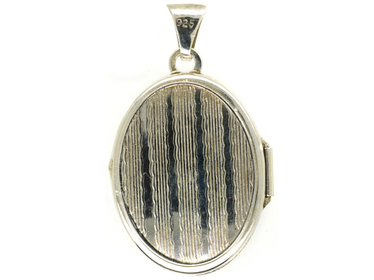 Small Silver Oval Locket With Flower Decoration