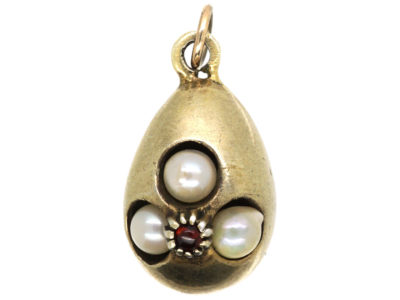 Edwardian Silver Gilt Egg Pendant set with Pearls & a Garnet