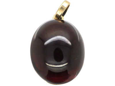 Victorian 15ct Gold Pendant set with a Cabochon Garnet with a Locket on Reverse