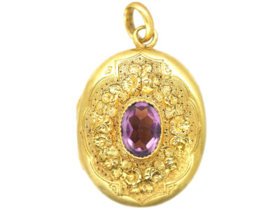Victorian Oval Gilt Metal Locket set with Amethyst Paste