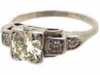 Art Deco Platinum Diamond Solitaire Ring with Step Cut Diamond Set Shoulders