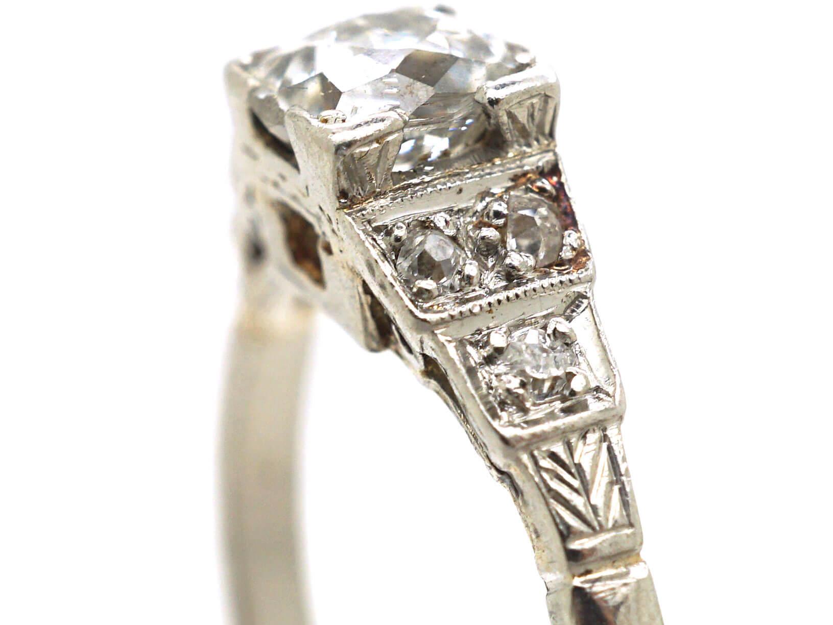 Art Deco Platinum & Diamond Solitaire Ring with Step Cut Diamond Shoulders