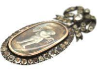 French Early 19th Century Silver & Paste Miniature Pendant of a Young Boy With Fishing Net & Fish