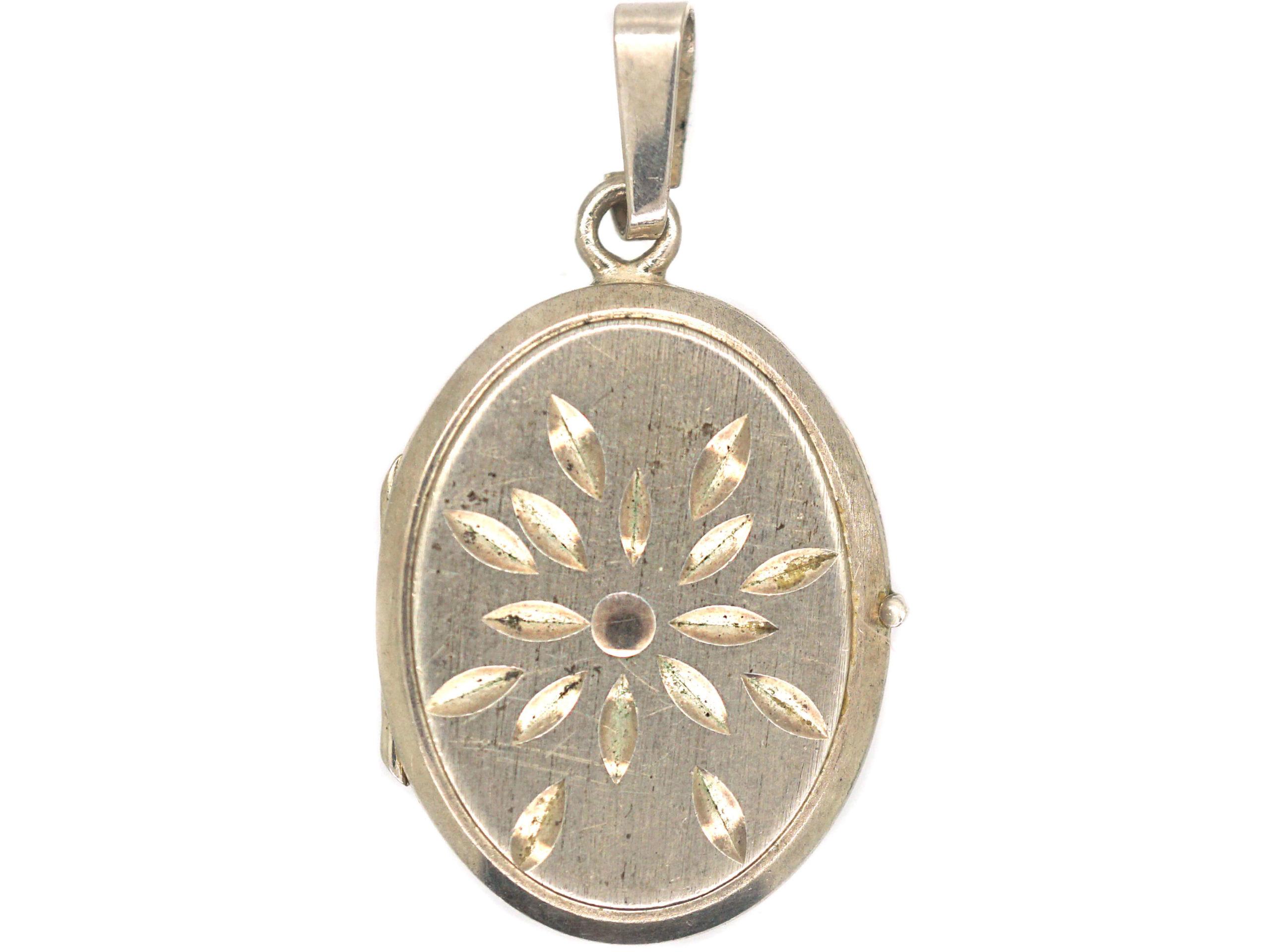 Silver Oval Locket with Starburst Motif