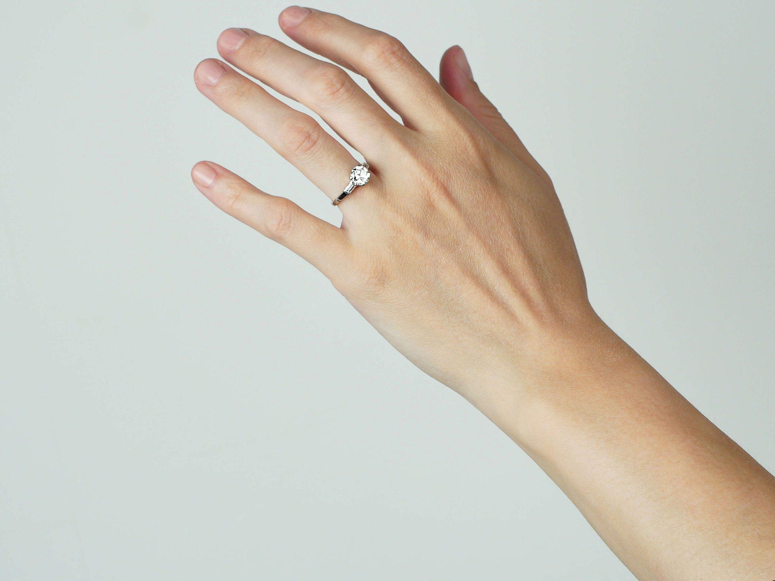 Art Deco Platinum, Diamond Solitaire Ring with Baguette Diamond Shoulders