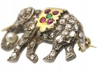 Edwardian Elephant Brooch set with Diamonds, Rubies, an Emerald & a Natural Pearl