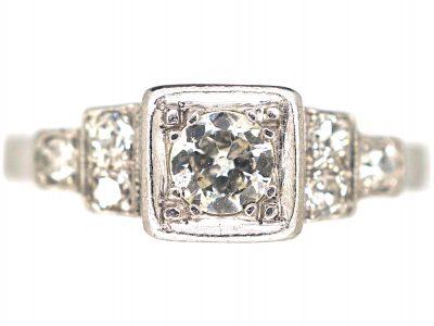 Art Deco Platinum, Diamond Solitaire Ring with Step Cut Shoulders set with Diamonds