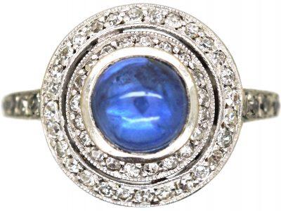 Art Deco Platinum, Cabochon Sapphire & Two Circle Diamond Ring